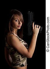 kvinna, gevär, holdingen