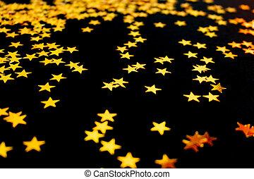 strödd, konfetti, bakgrund., gyllene, svart, stjärnor