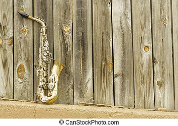 trä, saxofon, staket