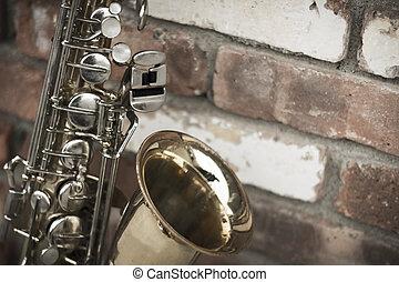 vägg, tegelsten, saxofon